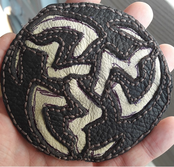 Handmade leather edge symbol prototype